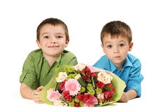 Two boys with bouquet of flower Royalty Free Stock Images