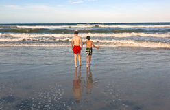 Two boys and brothers at the beach Stock Image