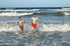 Two boys and brothers at the beach Stock Photos