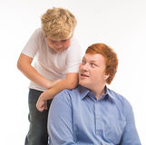 Two boys brothers and friends  studio portrait on white background playing Royalty Free Stock Images