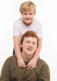 Two boys brothers and friends  studio portrait on white background playing Stock Photo