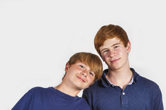 Two boys and brothers stand side by side Stock Image