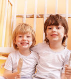 Two boys with brush Stock Image