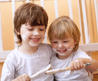 Two boys with brush Royalty Free Stock Photos