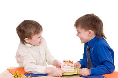 Two boys with cake Stock Photos