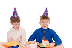Two boys with cake Stock Photography