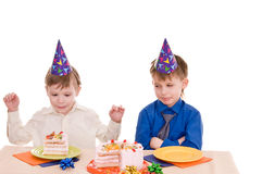 Two boys with cake Royalty Free Stock Images
