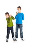 Two boys calling tin can phone. Royalty Free Stock Image