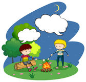 Two boys camping out at night Royalty Free Stock Photos
