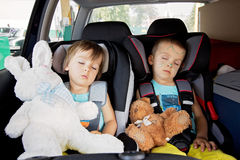 Two boys in car seats, travelling Royalty Free Stock Photo