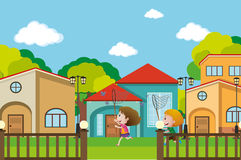 Two boys catching butterflies in the neighborhood Royalty Free Stock Photos