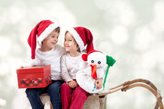 Two boys on christmas, having fun together Royalty Free Stock Images