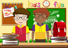 Two boys in the classroom Stock Images