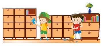 Two boys cleaning drawers and sweeping floor Royalty Free Stock Photos