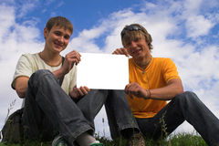 Two boys and clear paper Stock Photography