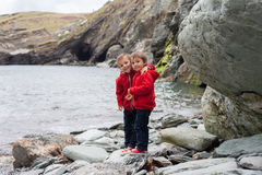 Two boys on the coast of the ocean, looking at the camera, smili Stock Photo