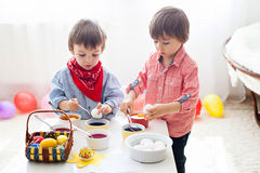 Two boys, coloring eggs for Easter at home Royalty Free Stock Photography
