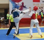 Two boys contest  in a Taekwondo competiton Stock Photos
