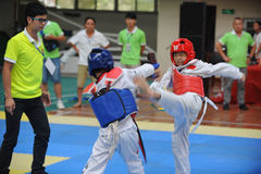 Two boys contest  in a Taekwondo competiton Stock Images