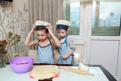 Two Boys Cooking dumplings Royalty Free Stock Photo