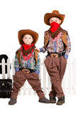 Two boys in cowboy costumes Stock Image