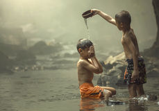 Two boys on the creek. Asia, Two boys showering together Royalty Free Stock Photos