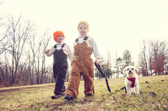 Two boys walking their dog on a leash Royalty Free Stock Images