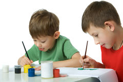 Two boys draw  gouache Stock Image