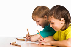 Two boys drawing Royalty Free Stock Images