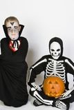 Two Boys Dressed In Halloween Costumes Stock Photo