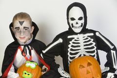 Two Boys Dressed In Halloween Costumes Holding Jack-O-Lanterns Royalty Free Stock Image