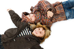 Two boys dressed in winter clothes Stock Images