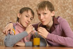 Two boys drinking Stock Photos