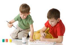 Two boys drow on floor Royalty Free Stock Photography
