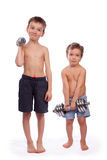 Two boys with dumbbells Stock Images