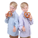 Two boys eating pretzels Stock Photos