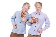 Two boys eating pretzels Royalty Free Stock Photo