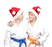 Two boys embrace in a kimono and wearing Santa hat Stock Photo