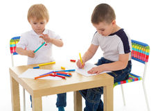 Two boys enthusiastically paint markers Royalty Free Stock Images