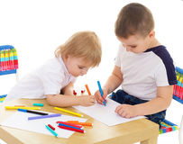 Two boys enthusiastically paint markers Stock Image