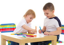 Two boys enthusiastically paint markers Royalty Free Stock Image