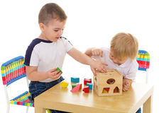 Two boys enthusiastically paint markers Royalty Free Stock Photography