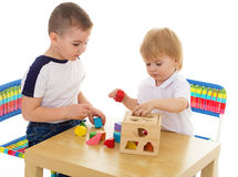 Two boys enthusiastically paint markers Stock Images