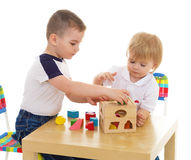 Two boys enthusiastically paint markers Stock Photography