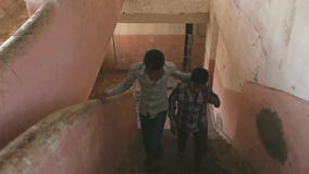 Two boys fastly walking up the stairs. MUMBAI, INDIA - 12 JANUARY 2015: Two boys fastly walking up the stairs stock video