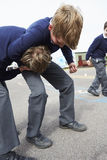 Two Boys Fighting In School Playground Royalty Free Stock Photos