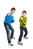 Two boys in a fighting stance. Royalty Free Stock Images