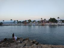 Two boys are fishing. Antalya Manavgat Side Beach Stock Photo
