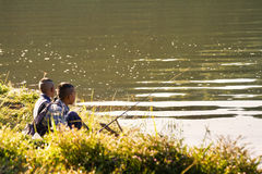 Two boys fishing in the morning. Royalty Free Stock Photography