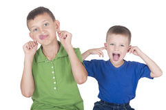 Two boys are fooled and crooked. On white Royalty Free Stock Images